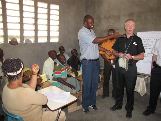 Archbishop Smith meets with rural leaders in the suburbs of Port-au-Prince.