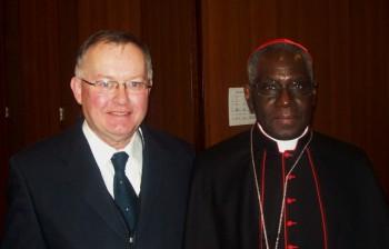 Pat Kennedy with Cardinal Sarah at Cor Unum Plenary Assembly