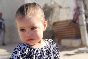 A Palestinian girl near her home in Gaza. photo by Liz O'Neill for catholic Relief Services.