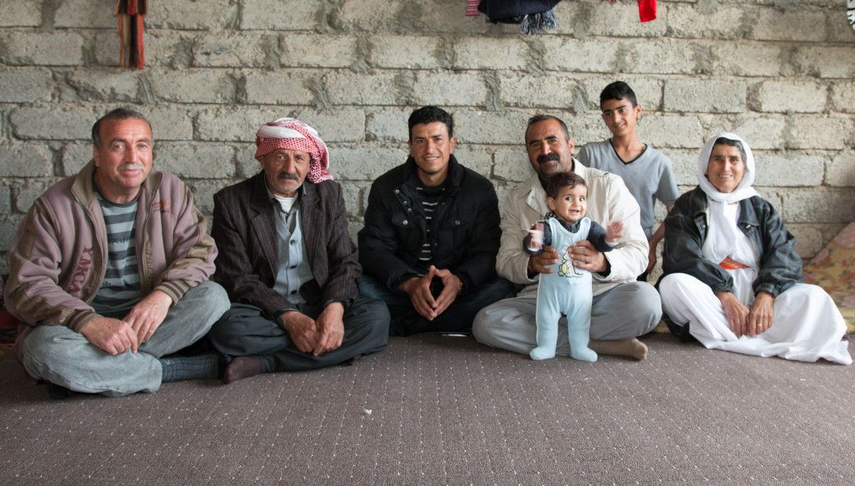 Yazidi family living in a renovated house in the village of Kharsinia