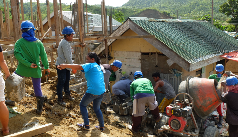 community members themselves building the school